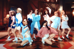 Members of the girl group, TWICE, in a still from the MV of their hit track,