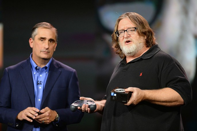 Intel Corp. CEO Brian Krzanich (L) looks on as Gabe Newell, co-founder of video game developer and distributor Valve, speaks during the 2014 International CES on Jan. 6, 2014.