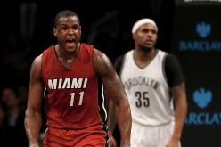 Dion Waiters of the Miami Heat celebrates his shot as Trevor Booker of the Brooklyn Nets defends in the fourth quarter at the Barclays Center on January 25, 2017 in the Brooklyn borough of New York City.