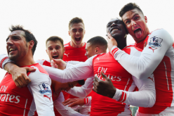 Members of the Arsenal squad celebrate during their match against West Bromich Albion in the Premier League.