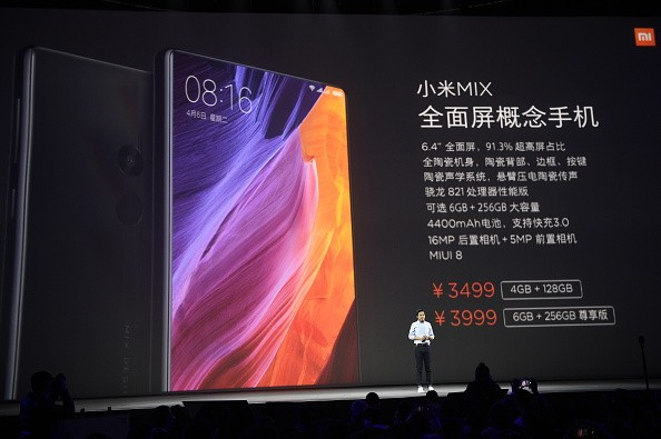 Lei Jun, Chairman and Chief Executive Officer of Xiaomi Inc., introduces Xiaomi VR glasses and new smartphones during a launch event at Peking University Gymnasium.