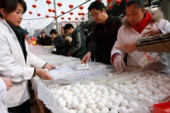 Customers buying glutinous rice balls in Beijing, China.