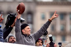 Tom Brady of the New England Patriots celebrates during the Super Bowl victory parade on February 7, 2017 in Boston, Massachusetts.