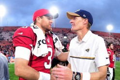 Head coach John Fassel of the Los Angeles Rams shakes hands with Carson Palmer of the Arizona Cardinals after a 44-6 Cardinals win at Los Angeles Memorial Coliseum.