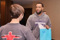 Derrick Williams(second from left) of The Sacramento Kings and a student from The United Nations International School attend an event recognizing New York City students for their efforts to help with the UNICEF Tap Project at Trump SoHo on March 8, 2014 i