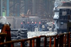 Investigators check the damaged steel casting workshop owned by state-run Angang Heavy Machinery in the city of Anshan in Liaoning Province.