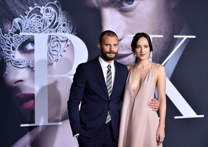 Actors Jamie Dornan and Dakota Johnson attend the premiere of Universal Pictures' 'Fifty Shades Darker' at The Theatre at Ace Hotel on February 2, 2017 in Los Angeles, California.
