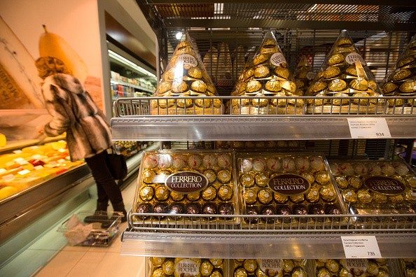 A customer shops near a display of Ferrero Rocher chocolates inside a supermarket.
