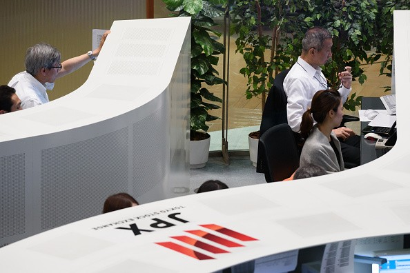 Employees working at the Tokyo Stock Exchange