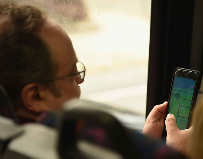 A man plays Pokemon Go while on the bus on August 10, 2016 in New York City.