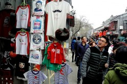Various T-shirts on sale along the popular Nanluoguxiang street in Beijing on the first day of the Lunar New Year.