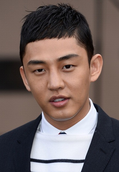 Yoo Ah In arrives at Burberry AW14 Menswear Show at Kensington Gardens on January 8, 2014 in London, England.