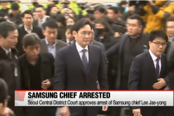 Samsung's Lee Jae-yong as he is being accompanied by his security details.