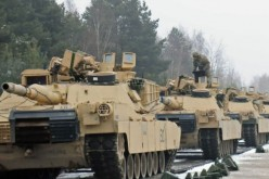 U.S. Army M1A2SEPV2 Abrams main battle tanks arrive in Poland to deter Russia.