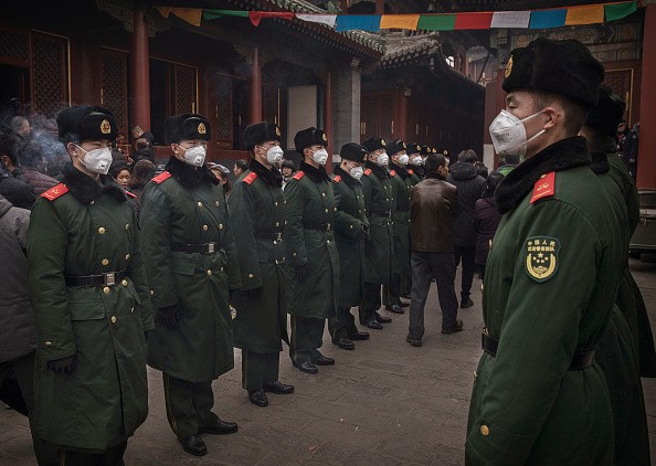 Chinese paramilitary police undertake crowd control duties on the first day of the Chinese Lunar New Year.