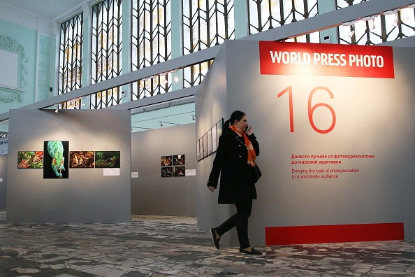 A woman attends an exhibition of award-winning photography for the 2016 World Press Photo contest.
