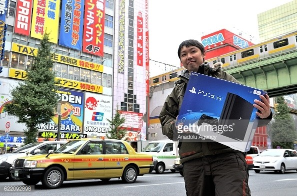 A customer holds PlayStation 4 Pro