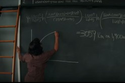 One of NASA's African-American human computer writes a formula on the board.