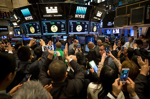 Traders work on the floor during the IPO of China Online Education Group at the New York Stock Exchange.