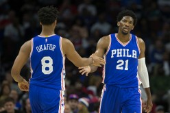 Jahlil Okafor of the Philadelphia 76ers slaps hands with Joel Embiid against the Oklahoma City Thunder at Wells Fargo Center on October 26, 2016 in Philadelphia, Pennsylvania.