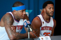 Derrick Rose of the New York Knicks looks on as Carmelo Anthony addresses the media during the New York Knicks Media Day at the Ritz Carlton on September 26, 2016 in White Plains, New York.