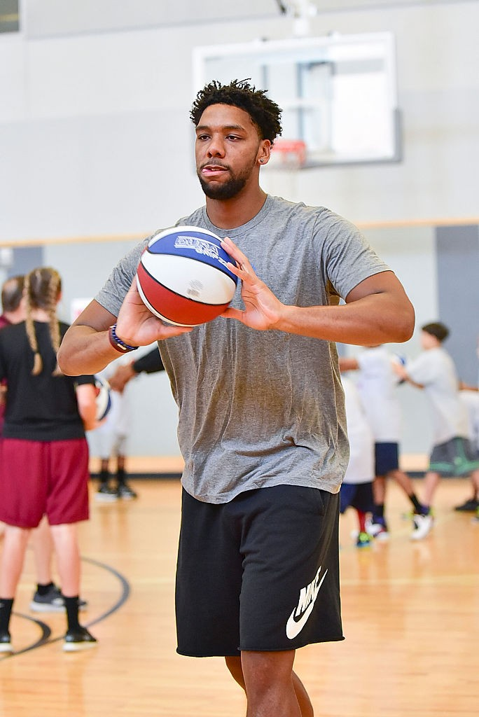 Jahlil Okafor helps children learn basketball skills during the Julius Erving Youth Basketball Clinic at the Salvation Army Kroc Center September 10, 2016 in Philadelphia, Pennsylvania.