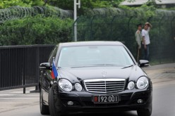 A diplomatic car carrying the Philippines' ambassador leaves the embassy in Beijing.