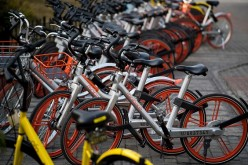 A photo that shows bicycles of the Mobike and Ofo sharing companies on the street in Shanghai.