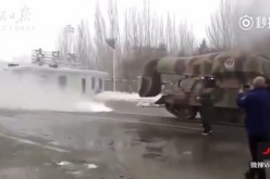 China's turbojet snow-blowing tank clears the road in Inner Mongolia.
