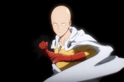 The great hero 'One Punch Man' Saitama positions his fist as he prepares to release a powerful punch.