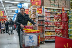 Walmart stores are decorated with Chinese lanterns and discount posters to attract customers.