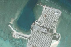 Satellite images show that one of the islands on the South China Sea is being used as a military facility.