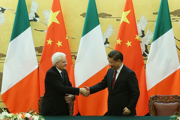 Chinese President Xi Jinping (R) shakes hands with Italian President Sergio Mattarella during a signing ceremony at the Great Hall of the People in Beijing.