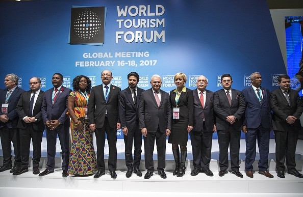Participants pose for a  photo during the 2017 World Tourism Forum.