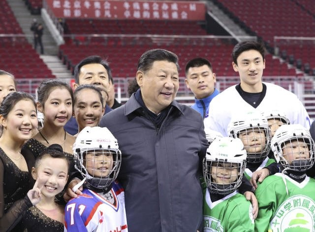 Chinese President Xi Jinping with young winter sports athletes.