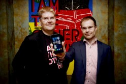One of the founders of Jolla company, Sami Pienimaki, and company CEO Tomi Pienimaki (R) present the new Jolla smartphone that uses Linux-based Sailfish operating system.