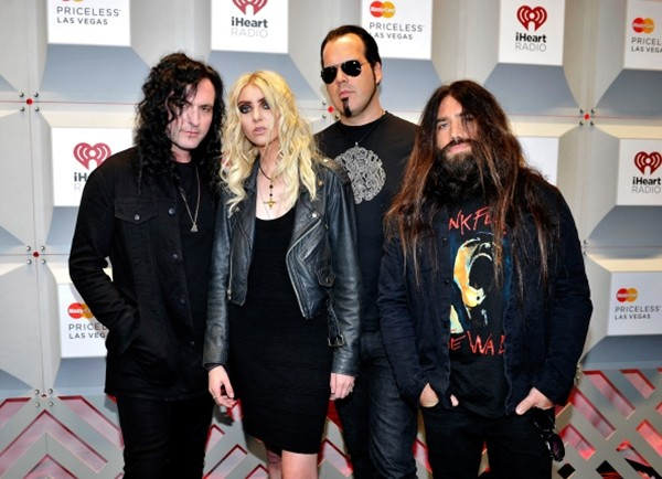 Ben Phillips, Taylor Momsen, Mark Damon and Jamie Perkins of the band The Pretty Reckless attend the 2014 iHeartRadio Music Festival at the MGM Grand Garden Arena on September 19, 2014 in Las Vegas, Nevada.