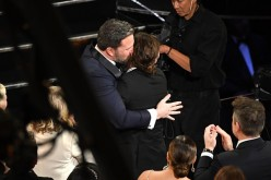 Ben Affleck kisses Casey Affleck during the 89th Annual Academy Awards at Hollywood & Highland Center on February 26, 2017 in Hollywood, California.