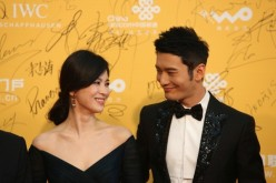 Korean actress Song Hye Kyo and Chinese actor Huang Xiaoming arrive for the red carpet of 4th Beijing International Film Festival at China's National Grand Theater on April 16, 2014 in Beijing, China.