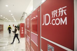 Employees at work in JD.com's headquarters in Beijing.