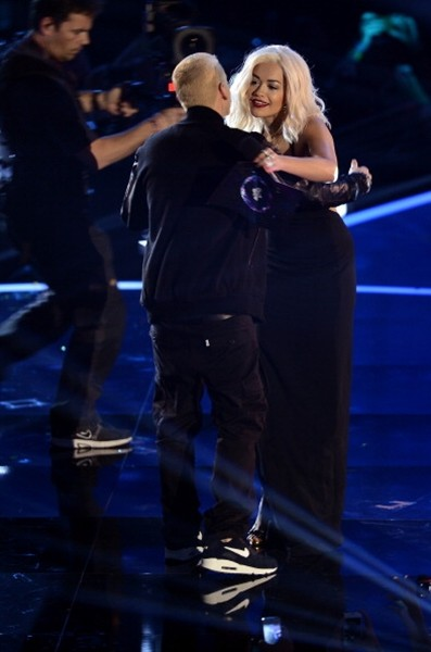 Rita Ora presents the Best Hip Hop award to Eminem onstage during the MTV EMA's 2013 at the Ziggo Dome on November 10, 2013 in Amsterdam, Netherlands.