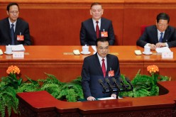 Chinese Premier Li Keqiang delivers his report during the opening session of the National People's Congress at The Great Hall of People on March 5, 2017.