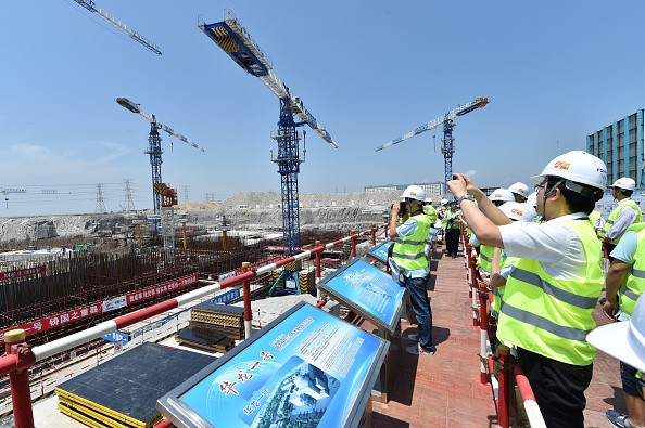 Public representatives and reporters visit a construction site of Hualong One pilot nuclear project in Fuqing, southeast China's Fujian Province.