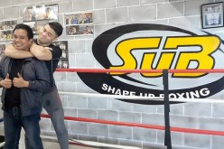 MMA fighter Mark Striegl jokingly gives filmmaker and screenwriter Conan Altatis a rear-naked choke.