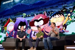 'South Park' creators Matt Stone and Trey Parker introduce the new video game 'South Park: The Fractured but Whole' with producer Jason Schroeder during an Ubisoft news conference at the E3 Gaming Conference.