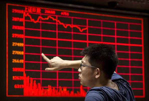 A Chinese day trader reacts as he watches a stock ticker at a local brokerage house on Aug. 27, 2015 in Beijing, China.