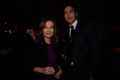 French actress Isabelle Huppert and South Korean actor Yoo Ji-Tae attend the French Night during the 16th Busan International Film Festival (BIFF) at Novotel on October 8, 2011 in Busan, South Korea.