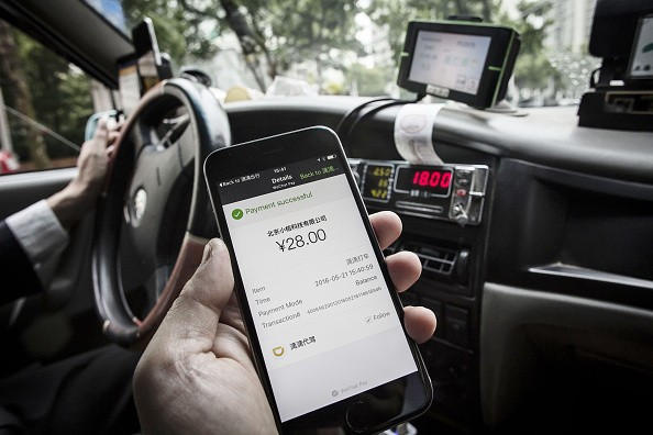 The payment confirmation page is displayed on the Didi Chuxing application in this arranged photograph taken in Shanghai, China.