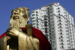A statue of Confucius is seen with high-rise buildings in the background on Sept. 28, 2006 in Changchun, Jilin Province, China.