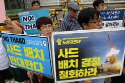 The Chinese government denounces South Korea's THAAD deployment.